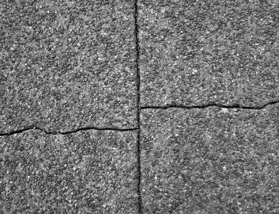 cracked concrete slabs needing repairs