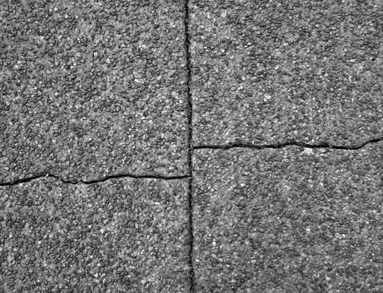 cracked concrete slabs needing repairs
